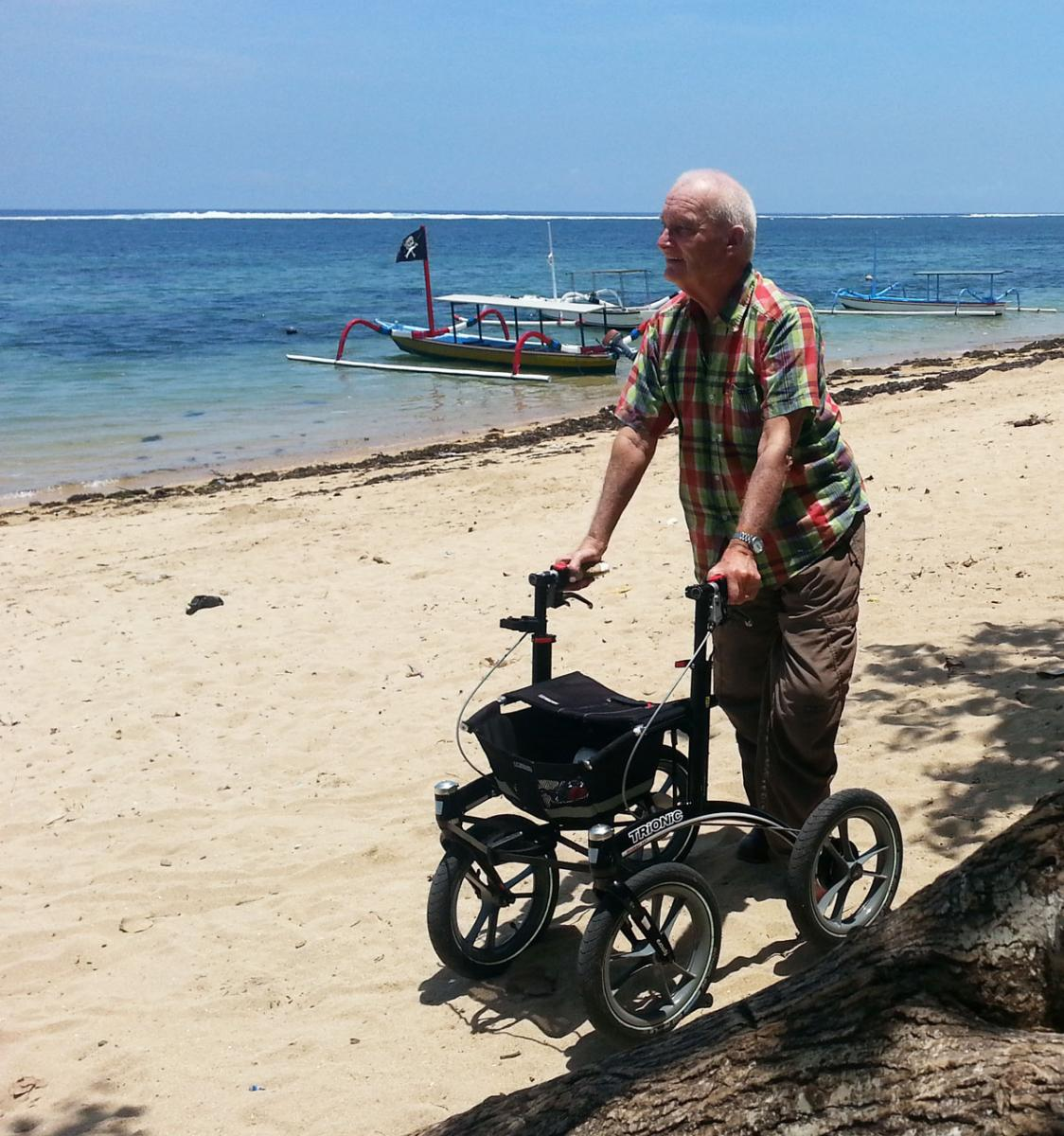 Wim Wollendorf enjoying a beach walk on Bali in Indonesia